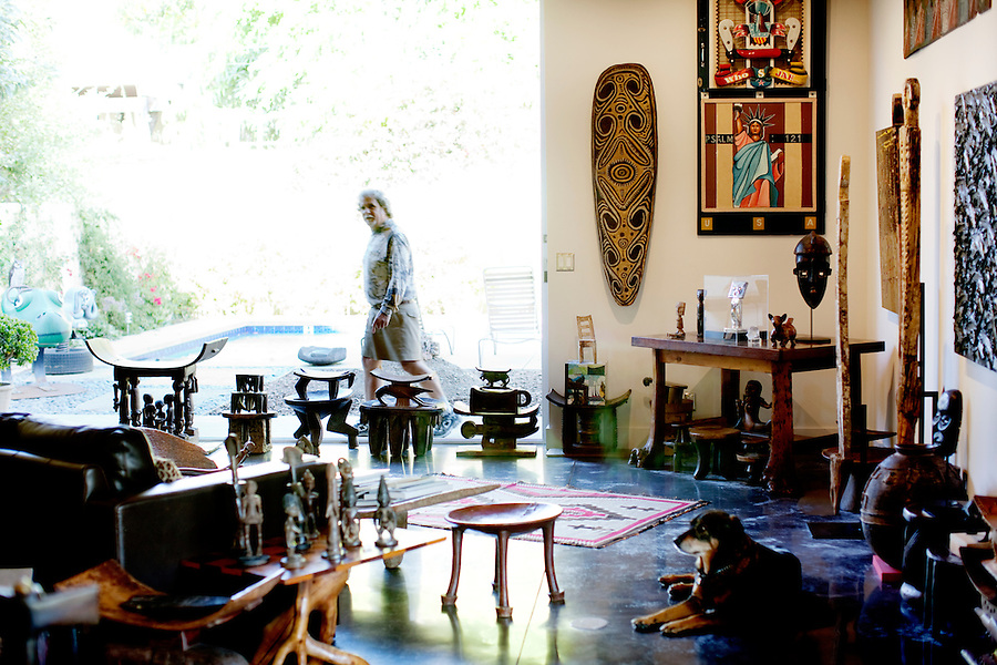 Los Angeles, California, November 14, 2009 - Ernie Wolfe, owner of the Ernie Wolfe Gallery and the most reknowned African at dealer in the country, in his Quonset hut inspired home along with his dog Mimi. ..CREDIT: Daryl Peveto/LUCEO for The Wall Street Journal.Homefront - Ernie Wolfe #1348.