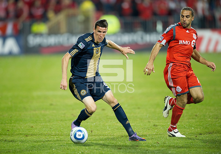 15 April 2010: Philadelphia Union forward Sebastien Le Toux #9 and Toronto FC midfielder Dwayne De Rosario #14 in action during a game between the Philadelphia Union and Toronto FC at BMO Field in Toronto..Toronto FC won 2-1..Photo by Nick Turchiaro/isiphotos.com.