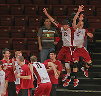 STANFORD, CA - January 13, 2012:  Players celebrate a point during Stanford's 25-13, 20-25, 25-14, 25-14 victory over Juniata in Stanford, California on January 13, 2012.