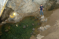 A tour guide explains floating volcanic rock in a pool at the bottom of Moaning Cavern in Vallecito, California November 24, 2008.. The cavern is 400 feet deep and is a popular tourist destination in California's gold country.  (Photo Copyright Alan Greth)