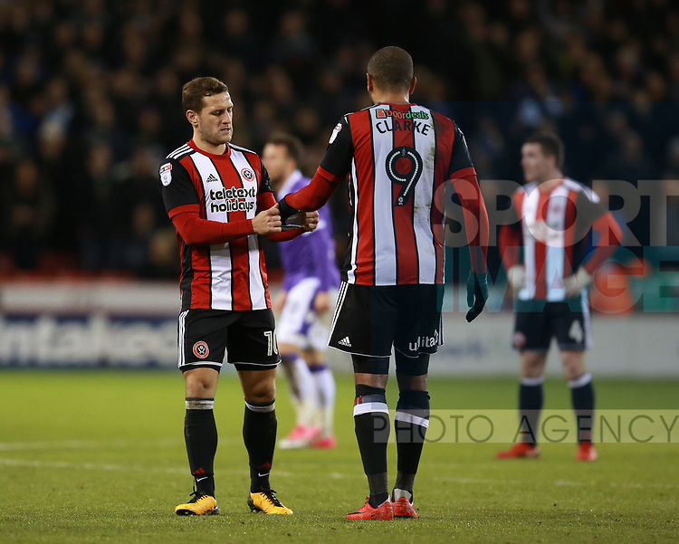 Billy Sharp of Sheffield Utd hands the captains armband over to Leon Clarke of Sheffield Utd during the Championship match at Bramall Lane Stadium, Sheffield. Picture date 30th December 2017. Picture credit should read: Simon Bellis/Sportimage