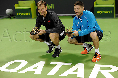 03.01.2014. Doha, Qatar.  Tomas Berdych (L) and Jan Hajek of Czech Republic pose after the men s doules final against Alexander Peya of Austria and Bruno Soares of Brazil in Qatar Open tennis tournament, Jan. 3, 2014. Tomas Berdych and Jan Hajek won 2-0.