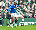:: RANGERS' EL HADJI DIOUF HOLDS OFF CELTIC'S MARK WILSON ::