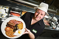 Canteen Manager at the Southampton Marlands Asda store Carla Thick as though serving one of the new dishes to be on the menu at all Asda store canteens. ??Date Taken: 16/04/10??Location:?Asda?The Marlands?Manchester Street.Southampton.SO14 7EG..Contact is 02380 229997.??Contact: Carla Thick??Commissioned by: Words&Pictures Alan Barton?Alan Barton.Head of Photography.Words&Pictures Ltd.The Editorial Design Centre,.Wharfebank House, Ilkley Road,.Leeds LS21 3JP.Tel: 01943 854800.Mobile: 07714 294391.www.wordsandpics.co.uk