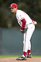 STANFORD, CA - March 27, 2011: A.J. Vanegas of Stanford baseball looks toward home before his windup during Stanford's game against Long Beach State at Sunken Diamond. Stanford won 6-5.