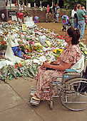 "Danette Byrne of Hampstead, MD looks at the flowers and gifts left in tribute to the late Princess Diana while waiting for the British Embassy in Washington, DC to open to sign the Book of Condolence for Princess Diana on September 6, 1997. Danette owns the ""Princess Diana Bride Doll"" seen at left and wanted to display it at the embassy in tribute to the late Princess. The Princess was killed in a car crash in Paris, France.  <br /> Credit: Ron Sachs / CNP"