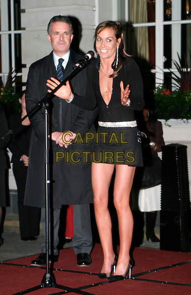 TARA PALMER TOMKINSON.lights the first ever Christmas tree at the Renaissance Chancery Court hotel.19/11/2003.full length, full-length, pleated miniskirt, kilt, plunging neckline, cleavage, diamante belt, hands, talking.www.capitalpictures.com.sales@capitalpictures.com.© Capital Pictures.