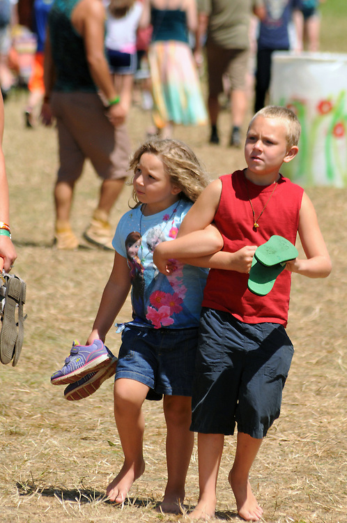 Two youngsters strolling the Midway of the Falcon Ridge Folk Festival, held on Dodd's Farm in Hillsdale, NY on Sunday, August 2, 2015. Photo by Jim Peppler. Copyright Jim Peppler 2015.