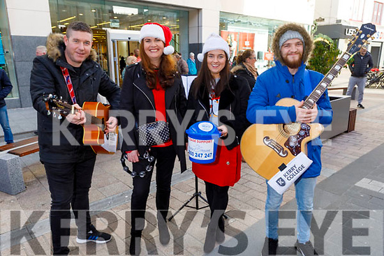 Kerry College students and teachers holding the their choral Christmas fundraiser for Pieta House on the Mall on Monday.  <br /> L to r: Denis O'Sullivan, Miranda Cournane, Joanne O'Mahoney and Kevin O'Connor.