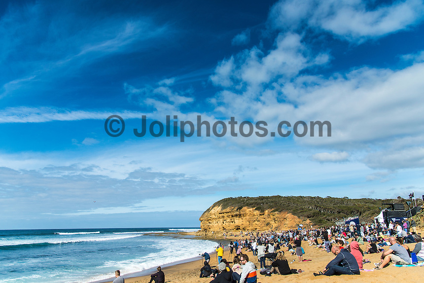 Bells Beach, Torquay, Victoria, Australia (Friday, March 25 2016): <br /> Round One of the Men's Rip Curl Pro hit the water at 8 am this morning and there were 6 heats run before the tide filled in and the event was called off for the day.<br /> There were light South West to North West winds through the morning with the swell in the 3'-4' range.<br /> <br /> Bells Beach has been hosting surfing tournaments for more than 50 years now, making it the most renowned spot on the raw and rugged southern coast of Victoria, Australia. The list of  Rip Curl Pro event champions is a veritable who's who of surfing icons, including many world champions.<br /> <br /> Surfing's greats have a way of dominating Bells. Mark Richards, Kelly Slater, and Mick Fanning all have four Bells trophies; Michael Peterson and Sunny Garcia, three; While Simon Anderson, Tom Curren, Joel Parkinson, Andy Irons, and Damien Hardman each grabbed a pair.<br /> <br /> The story is similar on the women's side. Lisa Andersen and Stephanie Gilmore have four Bells titles; Layne Beachley and Pauline Menczer, three; while Kim Mearig and Sally Fitzgibbons each have two.<br /> <br /> The 2016 event is about to kick off tomorrow and there was a packed warm up session at Bells this morning. <br /> Photo: joliphotos.com