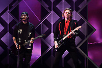 PHILADELPHIA, PA - DECEMBER 05: - Luke Hemmings and Michael Clifford of 5 Seconds of Summer perform onstage during Q102's Jingle Ball 2018 at Wells Fargo Center on December 5, 2018 in Philadelphia, Pennsylvania. Photo: imageSPACE/MediaPunch