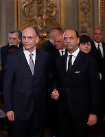 Il Presidente del Consiglio Enrico Letta, a sinistra, col Ministro dell'Interno e viceprimo ministro Angelino Alfano al termine della cerimonia del giuramento del nuovo governo al Quirinale, Roma, 28 aprile 2013..Italian Premier Enrico Letta, left, and Interior Minister and Deputy Premier Angelino Alfano look on at the end of the swearing in ceremony of the new government at the Quirinale presidential palace Rome, 28 April 2013..UPDATE IMAGES PRESS/Isabella Bonotto