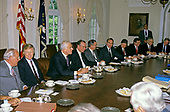 United States President George H.W. Bush meets with bipartisan, bicameral Congressional budget negotiators in the Cabinet Room of the White House in Washington, D.C. on May 15, 1990.  Recognizable, from left to right: US House Minority Leader Bob Michel (Republican of Illinois), US House Majority Leader Dick Gephardt (Democrat of Missouri), Speaker of the US House of Representatives Tom Foley (Democrat of Washington), President Bush, US Senate Majority Leader George Mitchell (Democrat of Maine), and US Senate Minority Leader Bob Dole (Republican of Kansas), unidentified, US Senator Pete Domenici (Republican of New Mexico), US Senator Lloyd Bentsen (Democrat of Texas), and US Senator Bob Packwood (Republican of Oregon).<br /> Credit: Ron Sachs / CNP