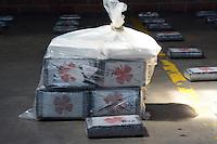 MEDELLIN -COLOMBIA-27-SEPTIEMBRE-2014.Mediante operacion NP Diran Republica 69 fase  XXXIX , fueron incautados 500 kilos de clorhidrato de cocaina . EL operativo se logro luego de ser interceptado el vehiculo   Eagle cisterna de placas TTG 343 a la altura del sector  Patio Bonito del municipio de Santuario en Antioquia , en el interior del receptaculo ( cisterna) se encontraron 582.6 Kilogramos , peso bruto de 500 kilos de clorhidrato de cocaina  .La droga fue mostrada en las instalaciones de La Sijin en Medellin./ By Diran Republic NP operation phase XXXIX 69, were seized 500 kilos of cocaine hydrochloride. The operation was after he intercepted the vehicle Eagle tank TTG 343 plates to match industry Patio Bonito municipality of Santuario in Antioquia, inside the receptacle (tank) achievement 582.6 kilograms were found, gross weight of 500 kilos of clorhidrato of cocaine drug was shown in the  SIJIN in Medellin.  Photo:VizzorImage / Luis Rios / Stringer