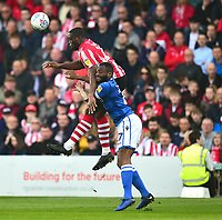 Lincoln City's John Akinde gets above Macclesfield Town's Nathan Cameron to win a header<br /> <br /> Photographer Andrew Vaughan/CameraSport<br /> <br /> The EFL Sky Bet League Two - Lincoln City v Macclesfield Town - Saturday 30th March 2019 - Sincil Bank - Lincoln<br /> <br /> World Copyright © 2019 CameraSport. All rights reserved. 43 Linden Ave. Countesthorpe. Leicester. England. LE8 5PG - Tel: +44 (0) 116 277 4147 - admin@camerasport.com - www.camerasport.com