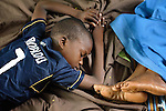 Two displaced children asleep on the floor inside a Catholic training center in Niamana, Mali. Several families displaced by the fighting in northern Mali took refuge in the center, and have received support from the ACT Alliance.