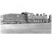 Side view of K-27 #451 at Alamosa scrapping operation.<br /> D&amp;RGW  Alamosa, CO  Taken by Thode, Jackson C.