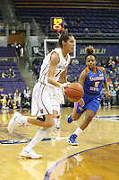SEATTLE, WA - DECEMBER 18: Washington's #14 Heather Corral drives to the basket against Savannah State.  Washington won 87-36 over Savannah State at Alaska Airlines Arena in Seattle, WA.