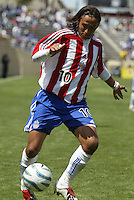 Chivas USA's Hector Cuadros dribbles the ball during a 2005 MLS game between the San Jose Earthquakes and Chivas USA on April 9, 2005 at Spartan Stadium in San Jose, California.  The game ended in a 3-3 tie.  Credit: JN Santos/ISI