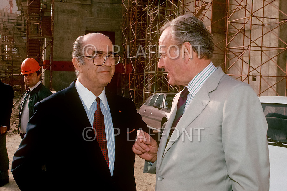 March 4, 1989, Casablanca, Morocco. The architect Michel Pinseau (R) and the contractor, Francis Bouygues (L), on an informal inspection meeting during the construction of the Hassan II Mosque. The mosque was completed in 1993.