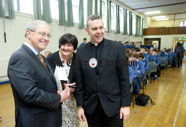 Kevin O'Malley, U.S. Ambassador to Ireland chats with Carmel Honan, Principal of St. Flannan's and Fr Iggy Mc Cormack following an event in the hall at St Flannan's College, Ennis. Photograph by John Kelly.