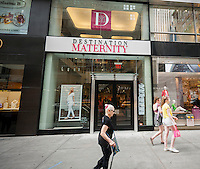 A Destination Maternity store in Midtown Manhattan in New York is seen on Thursday, July 3, 2014. The retailer, which also owns the A Pea in the Pod brand, has been rebuffed in two offers to purchase the UK retailer Mothercare, the last deal worth $456 million. If the deal eventually goes through Destination Maternity would trade in the US but be incorporated in the UK, which has a lower tax rate. It would become a tax emigrant. (© Richard B. Levine)