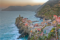 Early morning and the sky is a pastel shade of orange in the Cinque Terre overlooking the village of Vernazza. This image of Vernazza was taken just south of Vernazza. I had the place to myself except for some locals who were preparing for the day. This was a great way to start the day on the Italian Coast.