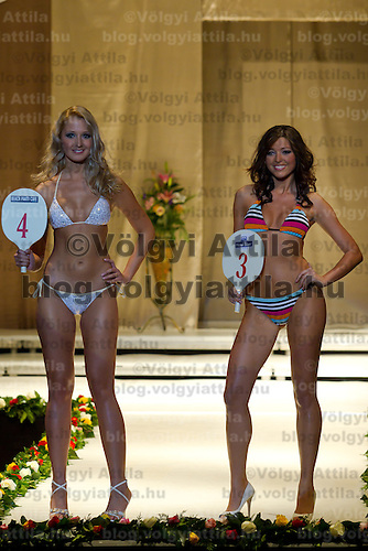 Edit Dara (left) and Anett Gyorfi (right) attends the Miss Hungary 2010 beauty contest held in Budapest, Hungary on November 29, 2010. ATTILA VOLGYI