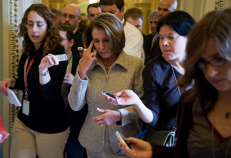 Speaker Nancy Pelosi, D-Calif., is questioned by reporters while en route to Senate Majority Leader Harry Reid's office, after a news conference following a leadership meeting in Pelosi's office, Jan. 19, 2010.