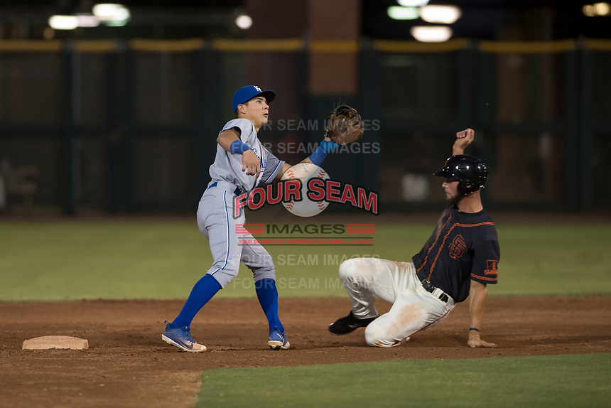 AZL Royals second baseman Kember Nacero (2) covers second base on a stolen base attempt by Zander Clarke (9) during an Arizona League game against the AZL Giants Black at Scottsdale Stadium on August 7, 2018 in Scottsdale, Arizona. The AZL Giants Black defeated the AZL Royals by a score of 2-1. (Zachary Lucy/Four Seam Images)