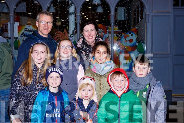 Oisin, Murphy, Caoimhe O'Connor, Eoin Clifford. Middle: Erin Murphy, Aisling O'Connor, Alexandra Wamba and Fionan O'Connor, back Tj and Selina O'Connor  at the  turning on the Christmas lights in Killorglin on Saturday evening