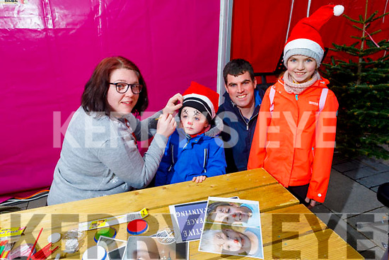 Ryan, Ryan, Shauna and Eoin Deedy ready to have their face painted by Jenny Cotter at the Snow Day in the square in Tralee on Saturday.