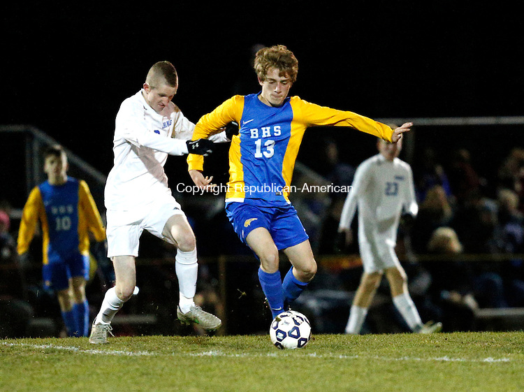 Burlington, CT- 12 November 2016-111216CM12-  Lewis Mills' Braden Fox left, goes in for the ball against Brookfield's Brit Wallman during their state tournament matchup on Saturday.  Mills would go onto lose, 4-3.    Christopher Massa Republican-American