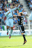 Kansas City forward Teal Bunbury (9) wins the aeriel battle with Brad Ring San Jose... Sporting Kansas City defetaed San Jose Earthquakes 2-1 at LIVESTRONG Sporting Park, Kansas City, Kansas.