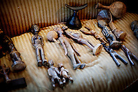 Los Angeles, California, November 14, 2009 - African sculptures line a couch in the home of Ernie and Diane Wolfe, owners of the Ernie Wolfe Gallery and the most reknowned African at dealers in the country. ..CREDIT: Daryl Peveto/LUCEO for The Wall Street Journal.Homefront - Ernie Wolfe #1348.