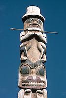 Gitxsan (Gitksan aka Tsimshian) Totem Pole, Ksan Historical Village and Museum in Hazelton, Northern BC, British Columbia, Canada - Male Figure sits atop Bear
