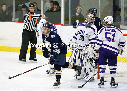 Alex Porrier (Johnson & Wales - 21), Derek Mohney (Curry - 30), Chris Mason (Curry - 51) - The Curry College Colonels defeated the Johnson & Wales University Wildcats 5-4 on Curry's senior night on Saturday, February 18, 2012, at Max Ulin Rink in Milton, Massachusetts.