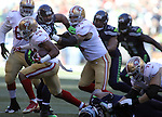 Seattle Seahawks defensive end Michael Bennett (72) tries to slow down San Francisco 49ers running back Shaun Draughn (24) at CenturyLink Field in Seattle, Washington on November 22, 2015.  The Seahawks beat the 49ers 29-13.   ©2015. Jim Bryant Photo. All RIghts Reserved.