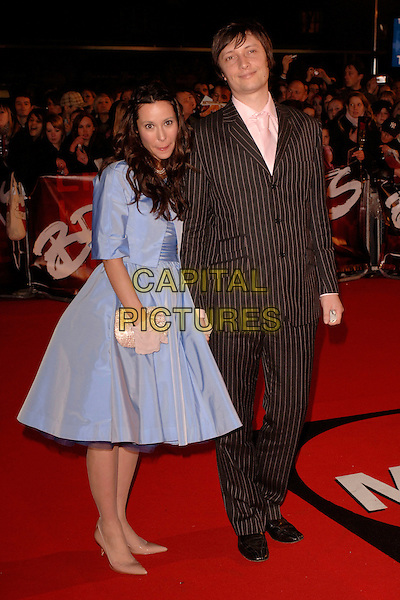 "NERINA PALLOT & GUEST.Arriving at the 2007 ""Brit Awards"" at Earls Court, London, England, 14th February 2007..full length blue fifties style dress.CAP/FIN.©Steve Finn/Capital Pictures."