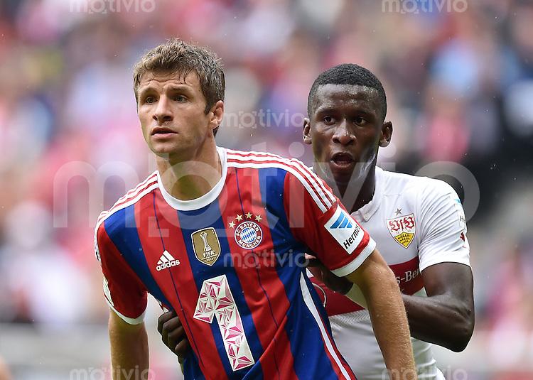 Fussball  1. Bundesliga  Saison 2014/2015   3. SPIELTAG FC Bayern Muenchen - VfB Stuttgart       13.09.2014 Thomas Mueller (li, FC Bayern Muenchen) und Antonio Ruediger (VfB Stuttgart) am Ball
