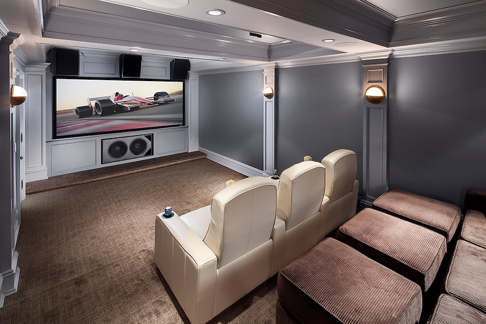 "This theater has an Epson Pro-cinema projector, 125"" diagonal screen, Klipsch theater speakers and subwoofer, and a Savant control system."
