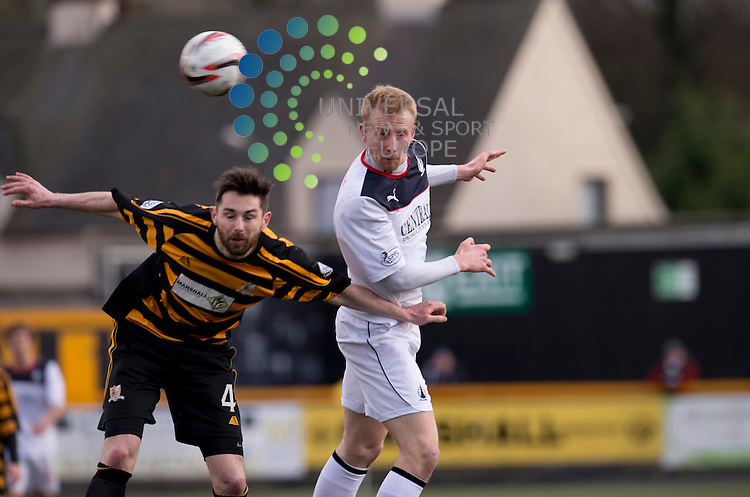 Mark Beck of Falkirk wins an aerial duel against Ben Gordon of Alloa during the Scottish Championship match  between Alloa and Falkirk at Recreation Park, Alloa. 22 March 2014. Picture by Ian Sneddon / Universal News and Sport (Scotland). All pictures must be credited to www.universalnewsandsport.com. (Office) 0844 884 51 22.