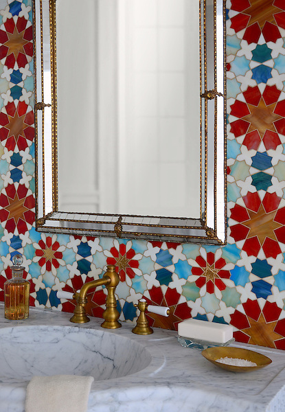 Granada Grande, a waterjet jewel glass mosaic shown in Gold Glass, Tiger's Eye, Garnet, Peacock Topaz, Quartz, and Aquamarine, is part of the Miraflores collection by Paul Schatz for New Ravenna.