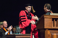 Jorge Gonzalez, VP for Academic Affairs and Dean of the College presents The Linda and Tod White Teaching Prize to sociology professor Richard Mora. Occidental College welcomes incoming first-year students during Convocation, the formal gathering that marks the beginning of the academic year, August 27, 2014 in Thorne Hall. (Photo by Marc Campos, Occidental College Photographer)