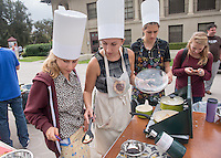 Lillian Krovoza '15 (black top), Becca Rich '15 (leopard top), Nina Greenebaum '15 (gray sweater). Occidental College students compete in the Iron Chef competition, sponsored by FEAST, in the AGC Quad on Oct. 31, 2014. Competitors were given ingredient options and a time limit to create a dish, which was judged by faculty and staff. (Photo by Marc Campos, Occidental College Photographer)