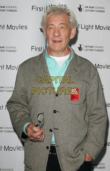 "SIR IAN McKELLEN.Attending the First Light Film Awards at the Odeon cinema, Leicester Square, London, England, March 4th 2008..half length green jacket sticker that reads ""Some people are Gay. Get over it"" badge slogan.CAP/ROS.?Steve Ross/Capital Pictures"