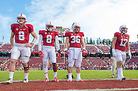 STANFORD, CA - NOVEMBER 15, 2014:  Captains  Kevin Hogan, Jordan Richards, Lee Ward, and  A.J. Tarpley before Stanford's game against Utah. The Utes defeated the Cardinal 20-17 in overtime.