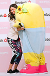 """(L to R) Australian model Miranda Kerr gets a affectionate hug from the Japanese mascot character Funassyi  during the Reebok Skyscape Fashion Show on April 15, 2015, Tokyo, Japan. Miranda Kerr, who is very popular in Japan, is the Reebok global ambassador for the new footwear line """"Skyscape"""". Models Anne Nakamura, Tina Tamashiro and Funassyi, mascot of Funabashi city in Chiba, also attended the event. (Photo by Rodrigo Reyes Marin/AFLO)"""