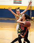 WATERBURY,  CT-021819JS25-  Watertown's Nicole DeFeo tries to get a pass off while being tightly defended by Holy Cross' Alyssa Hebb (10) during their NVL semi-final game Monday at Kennedy High School in Waterbury. <br /> Jim Shannon Republican American
