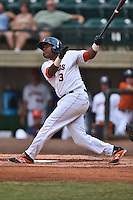 Greenville Astros second baseman Juan Santana #3 swings at a pitch during a game against the Pulaski Mariners at Pioneer Park July 12, 2014 in Greenville, Tennessee. The Mariners defeated the Astros 11-10. (Tony Farlow/Four Seam Images)